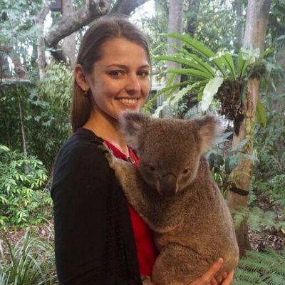 Julia Gauberg holds a koala bear in Australia