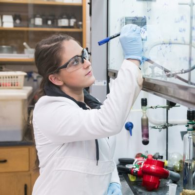 A student conducts research in one of the science labs
