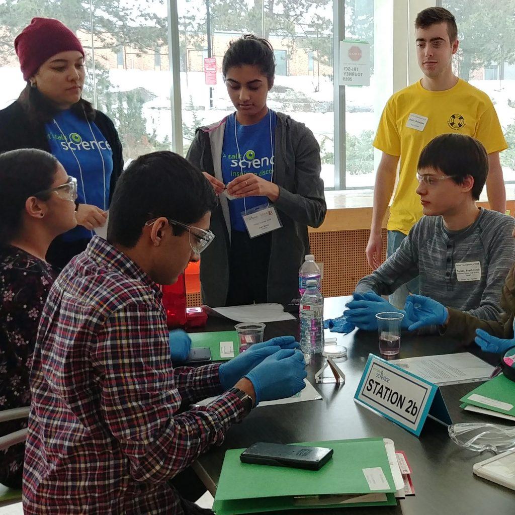 Tri-Sci Tourney participants working out a problem
